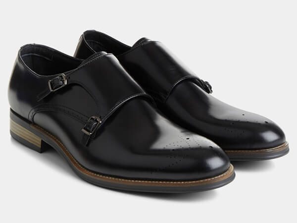 Black monk shoes with broguing from Moss Bros